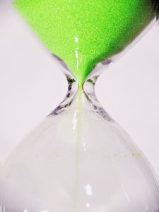 egg timer with lime green sand close up
